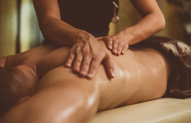 Oil Massage of Male Torso stock photo