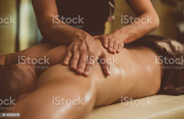 Oil Massage Of Male Torso Stock Photo - Download Image Now