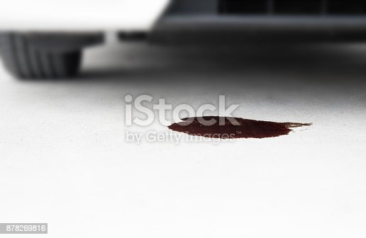 istock Oil of car auto mobile leak and drop on concrete floor parking with copy space 878269816