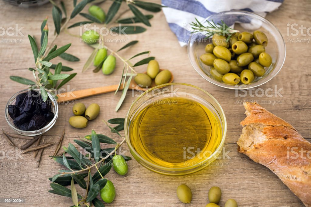 oil olive-green olive with ciabatta bread and black olive over of wooden table zbiór zdjęć royalty-free