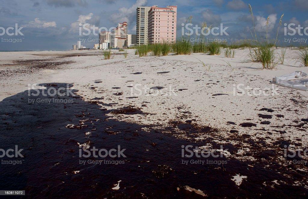 Oil on beach sand from oil spill stock photo