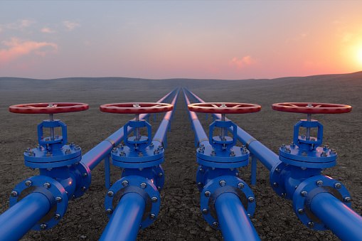 Oil Or Gas Transportation With Blue Gas Or Pipe Line Valves On Soil And Sunrise Background