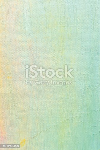 504223972 istock photo Oil paint background, bright ultramarine blue, yellow, pink, turquoise canvas 491246199