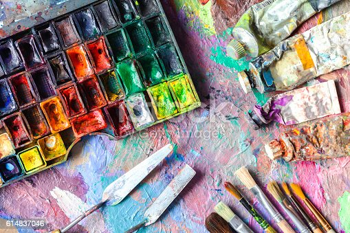 510006691 istock photo oil paints and paint brushes on a palette 614837046