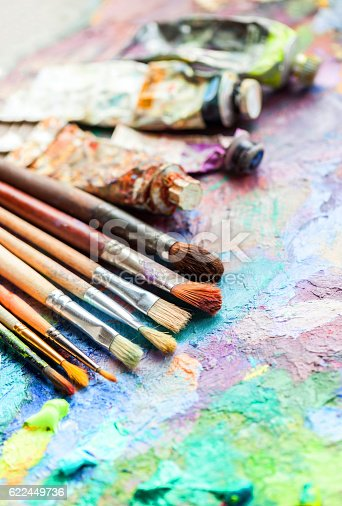 510006691 istock photo oil paints and paint brushes on a palette 622449736