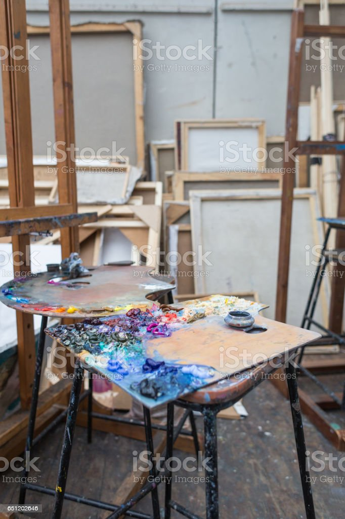 Oil Paints on Palettes and Art Materials in Studio stock photo