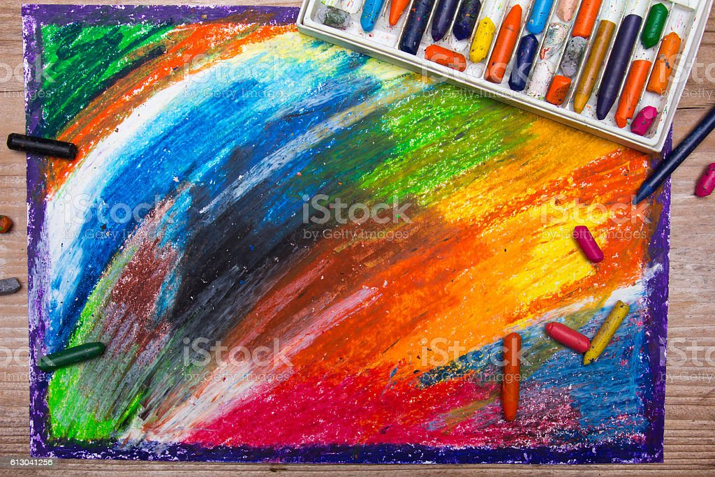 Oil Pastels Drawing And Crayons On Wooden Background Stock