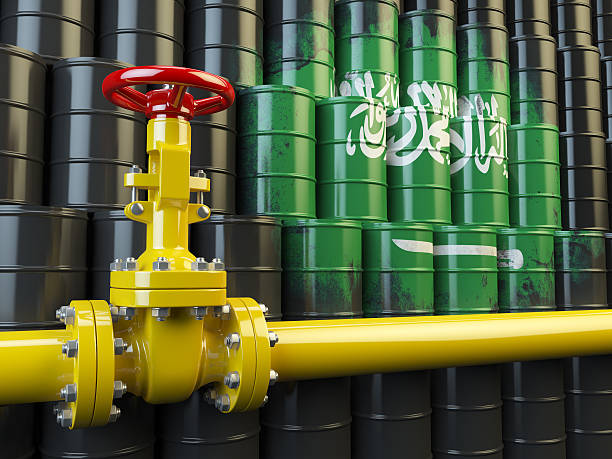 Oil pipe line valve in front of  Saudi Arabia flag Oil pipe line valve in front of the Saudi Arabia flag on the oil barrels.  Gas and oil fuel energy concept. 3d illustration saudi arabia stock pictures, royalty-free photos & images