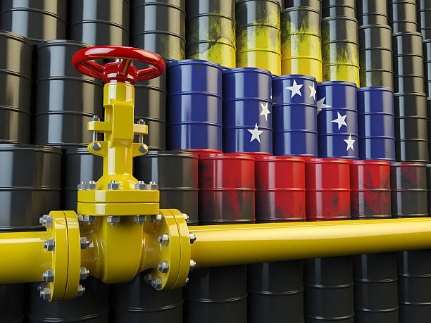 oil pipe line valve in front of the flag venezuela - venezuela stock photos and pictures