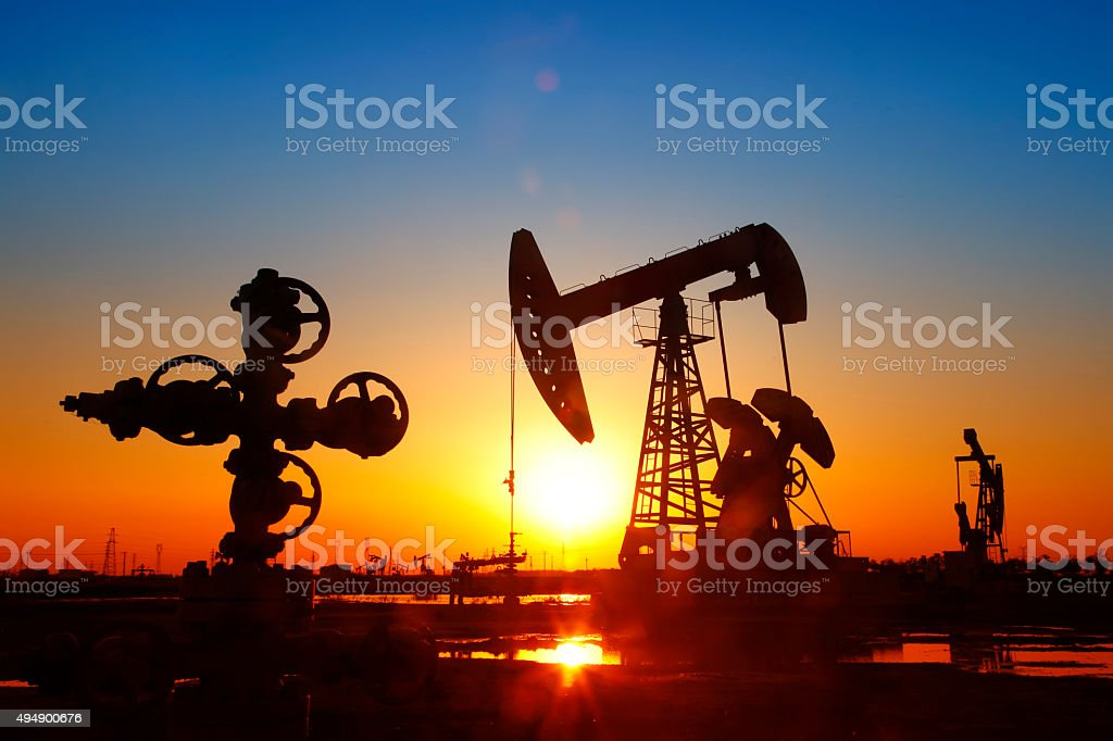 Oil pipeline and pumping unit of the silhouette stock photo