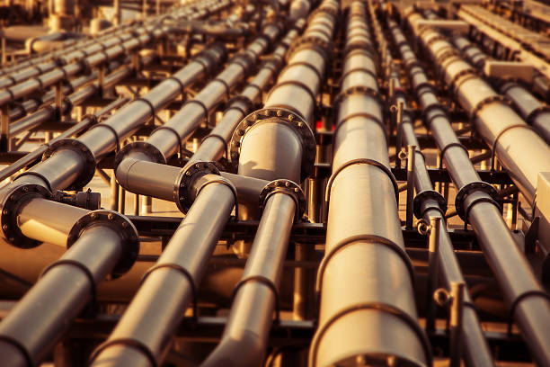 oil pipeline colored blurred background. - crude stock pictures, royalty-free photos & images