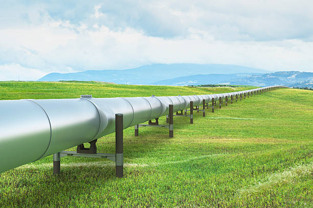 oil pipeline in green landscape - crude oil stock photos and pictures