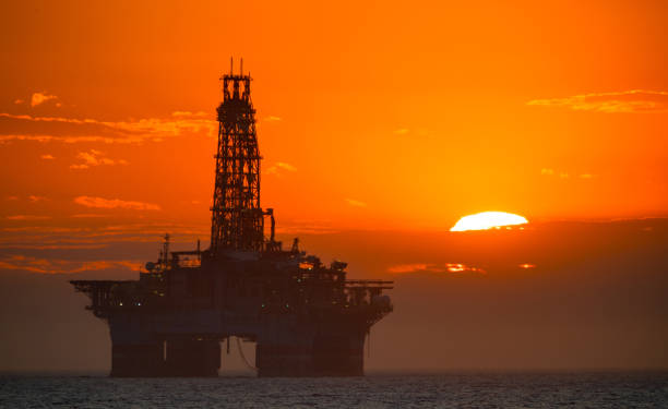 oil platform at sunset - crude stock pictures, royalty-free photos & images