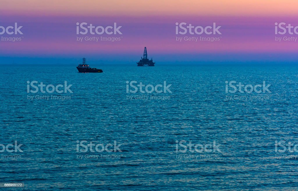 Oil platform in the sea stock photo