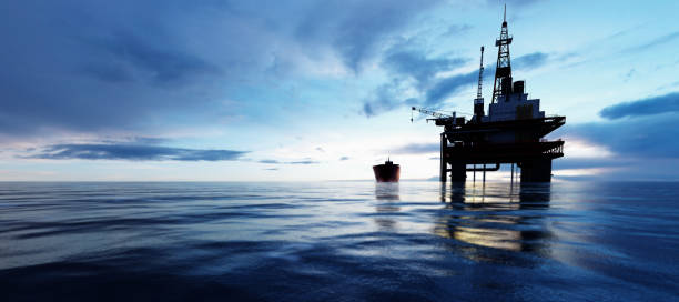 Oil platform on the ocean. Offshore drilling for gas and petroleum stock photo