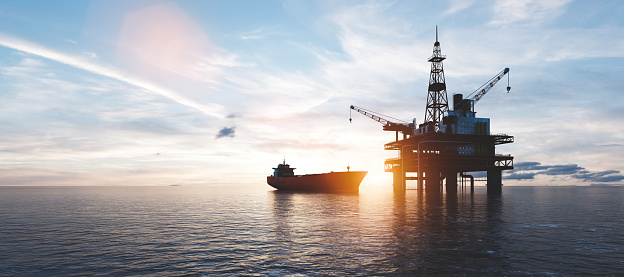 Oil platform on the ocean. Offshore drilling for gas and petroleum or crude oil. Industrial