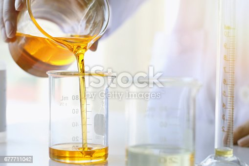 istock Oil pouring, Equipment and science experiments, Formulating the chemical for medicine, Organic pharmaceutical 677711042