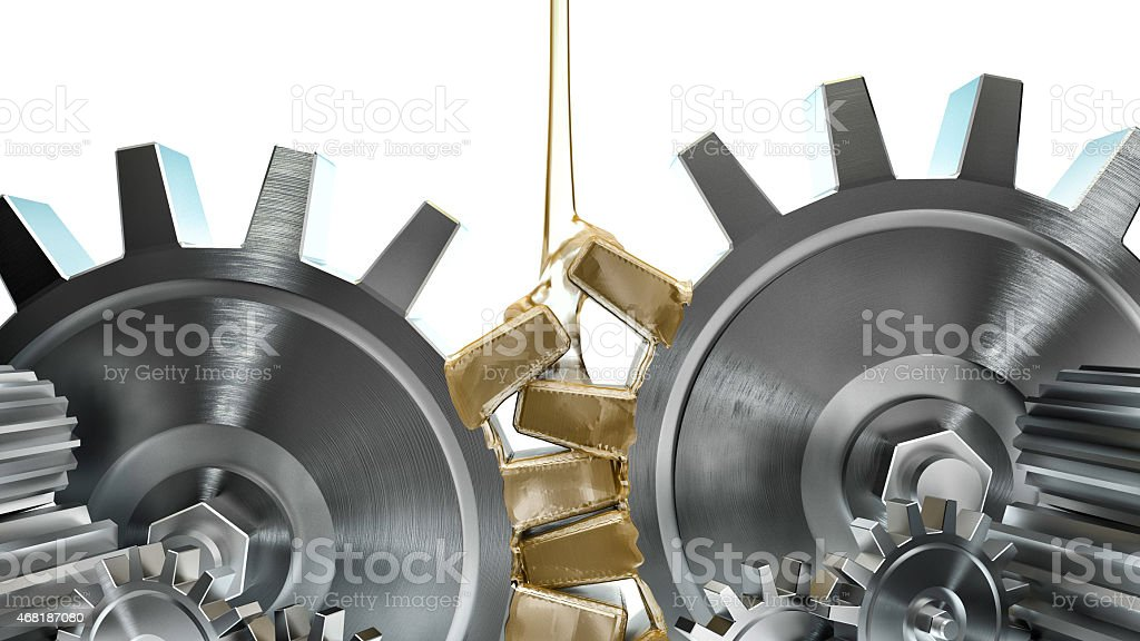 Oil pouring on metal gears on white background stock photo