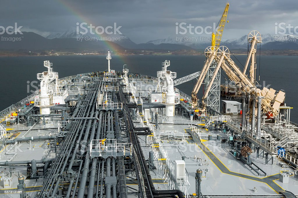 Oil product tanker loading from terminal stock photo