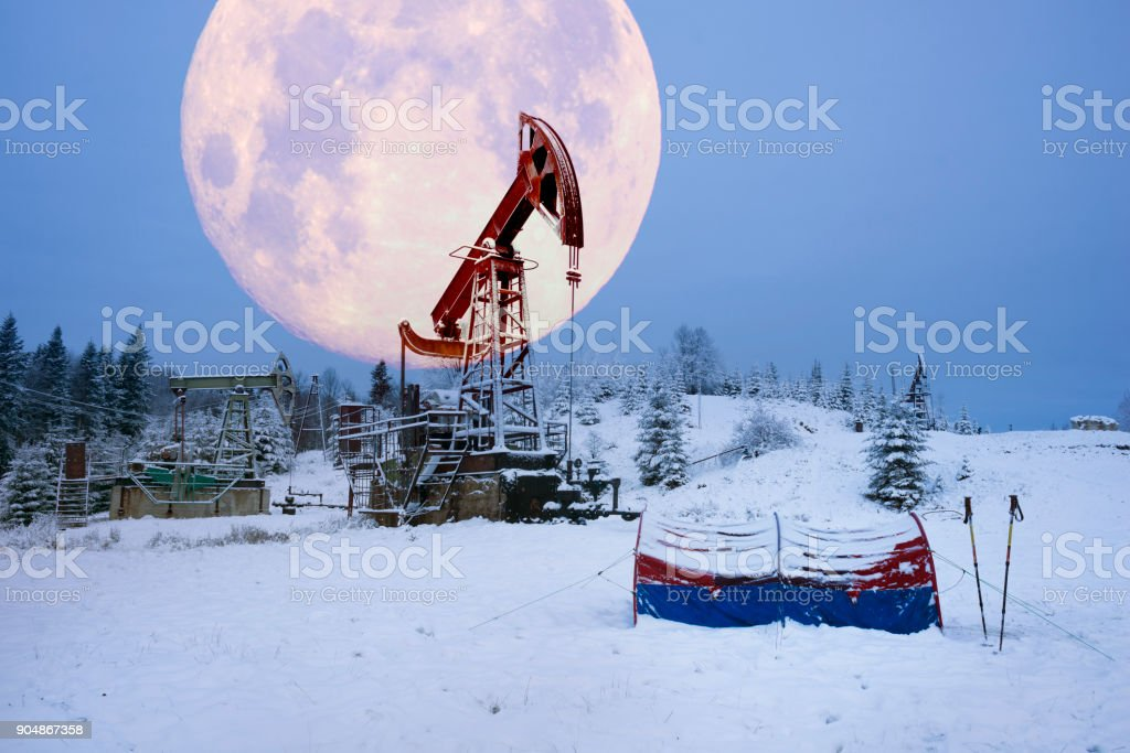 Oil production in the winter on Mount Synechka stock photo