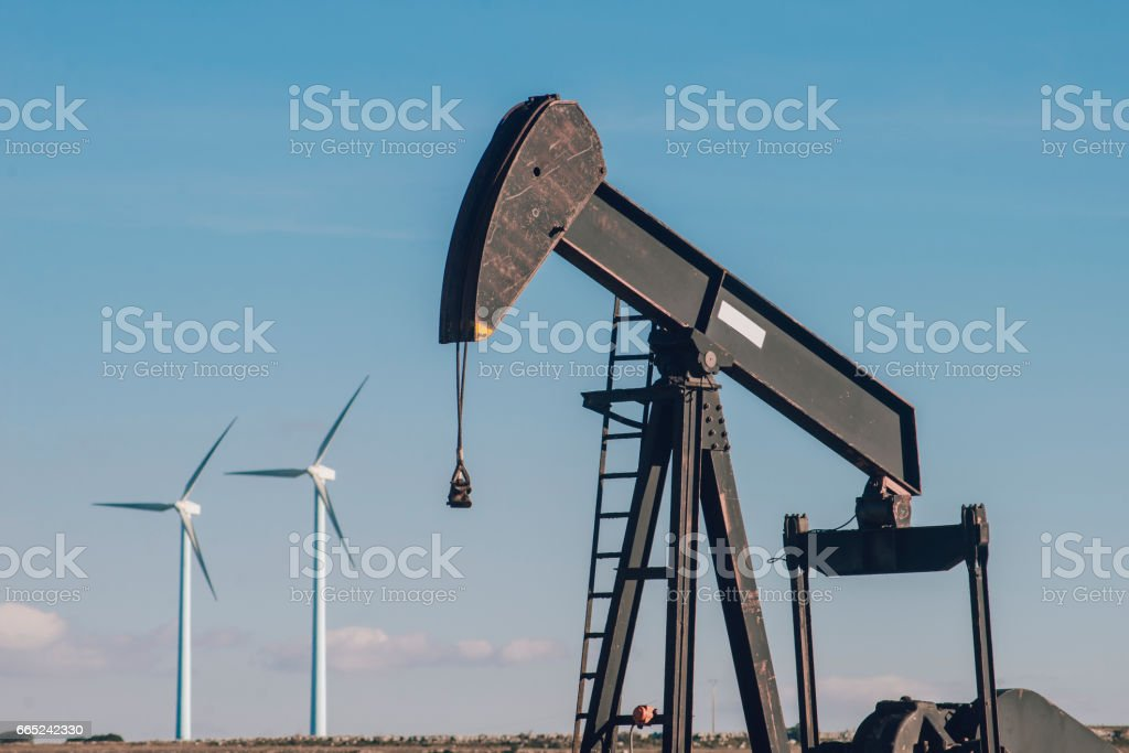 Oil pump and windmills stock photo