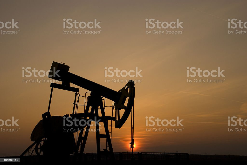 oil pump at sunset royalty-free stock photo