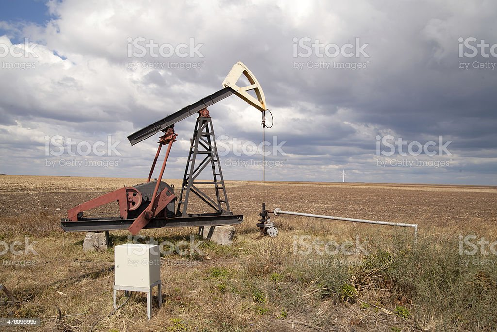 oil pump, cloudy sky royalty-free stock photo