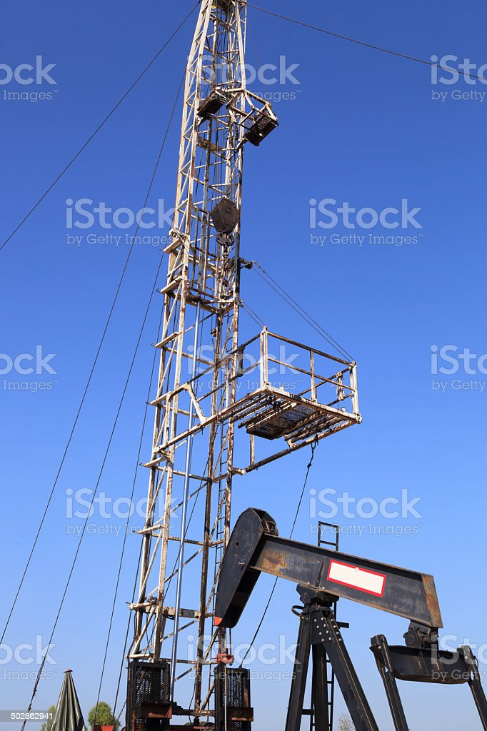 Oil Pump Jack And Workover Rig Stock Photo - Download Image