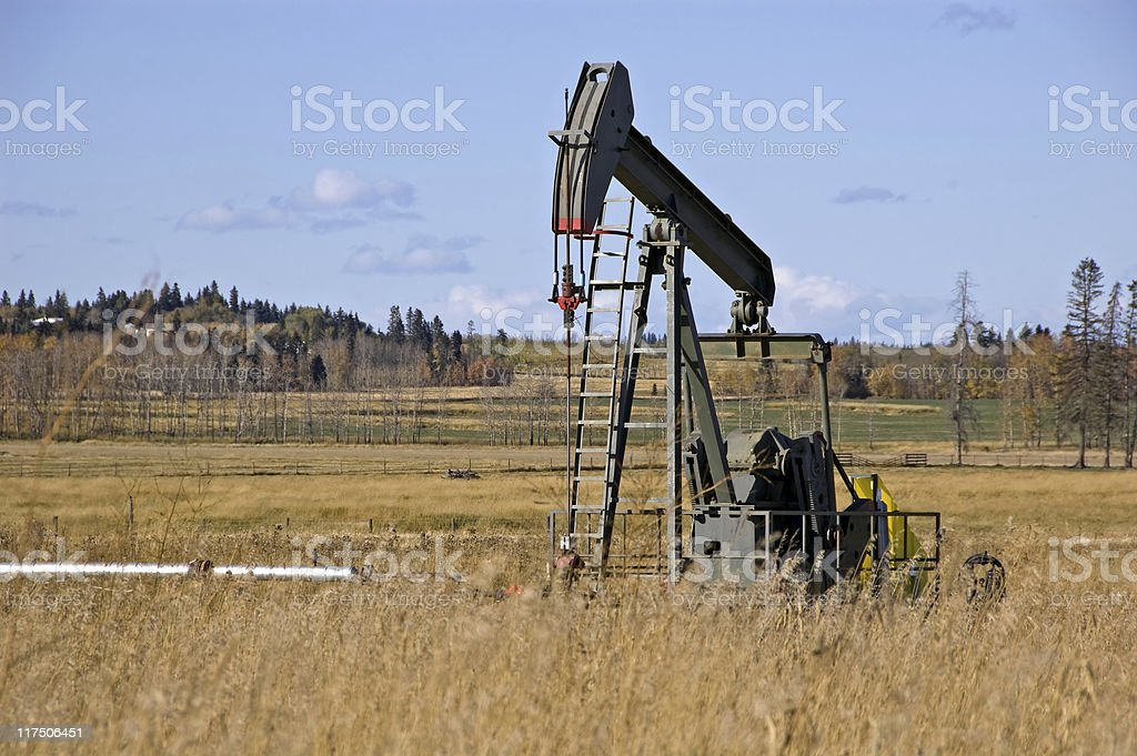 Oil pump jack in field royalty-free stock photo