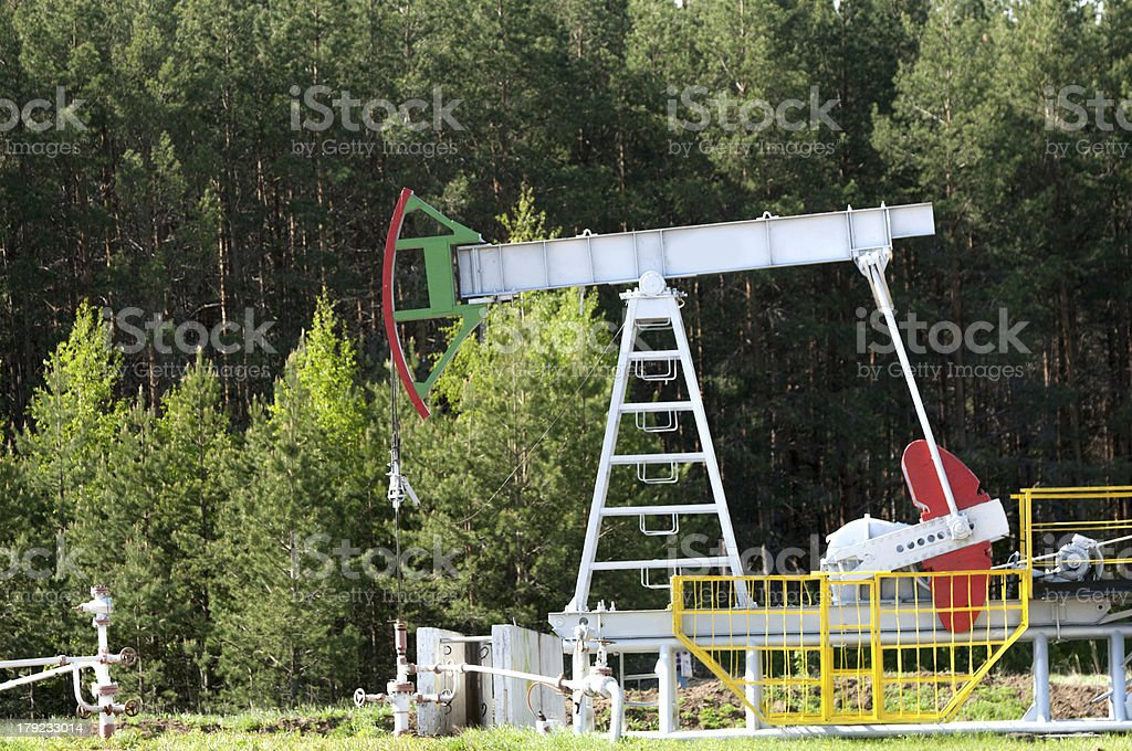 oil pump jack in operation royalty-free stock photo