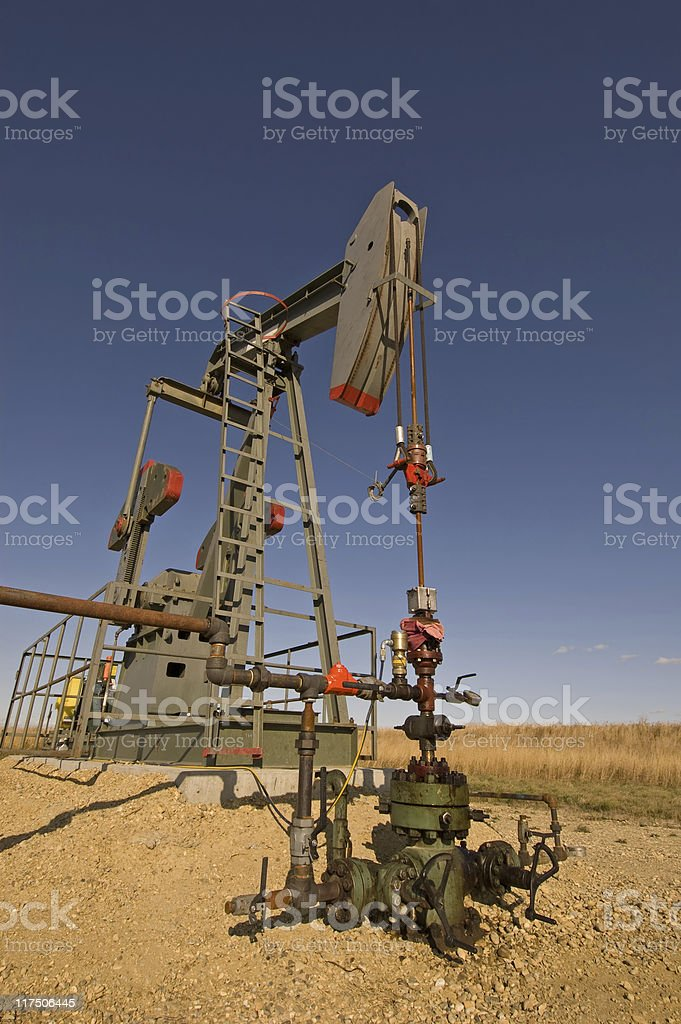 Oil pump jack on the Prairies royalty-free stock photo