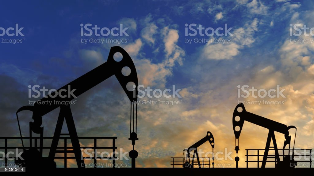 oil pump oil rig energy industrial machine for petroleum in the sunset background for design stock photo