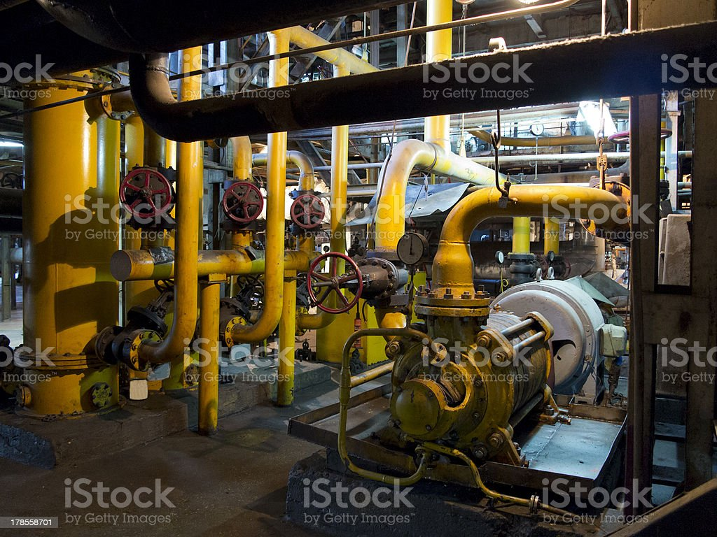 Oil pump, pipes tubes and equipment at industrial plant royalty-free stock photo