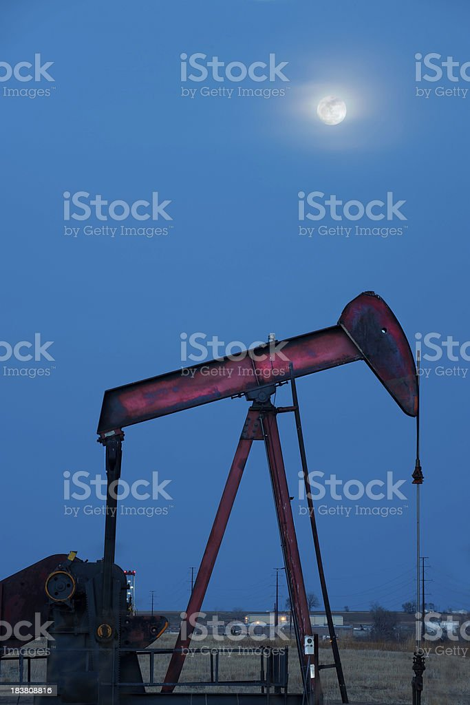 Oil Pump with Full Moon in Background at Twilight stock photo