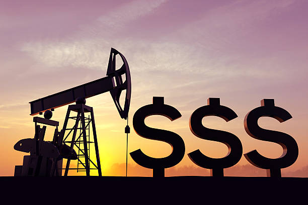 Oil pump with the dollar symbol stock photo