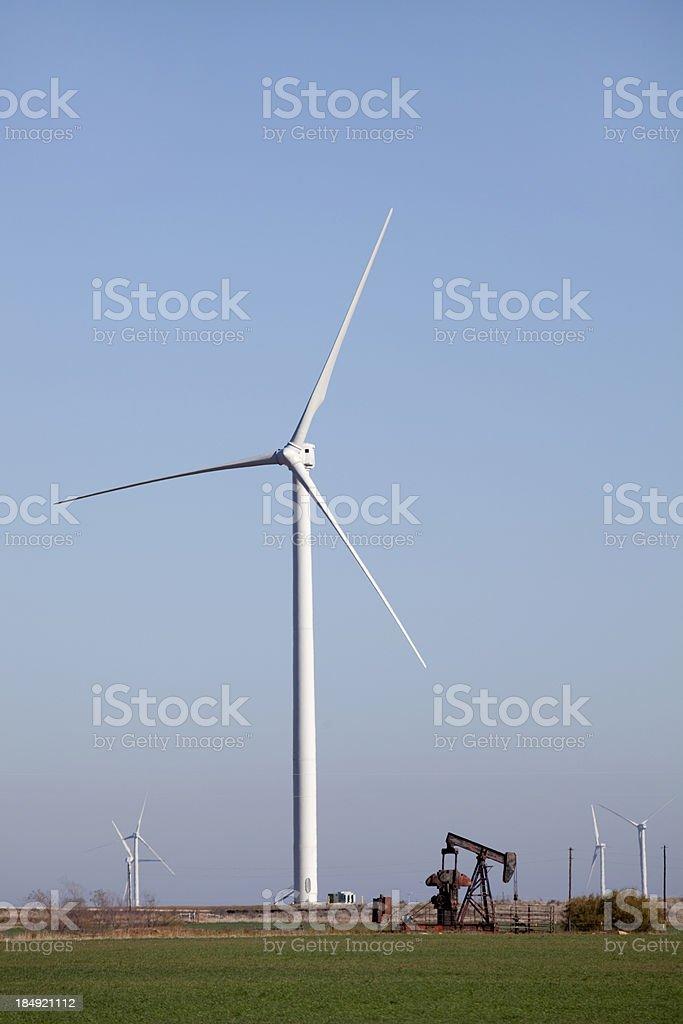 Oil Pumper and Trinity Hills Wind Farm turbines Olney Texas stock photo
