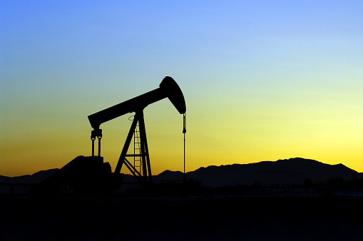 Oil Pump silhouetted against a mountain sunset