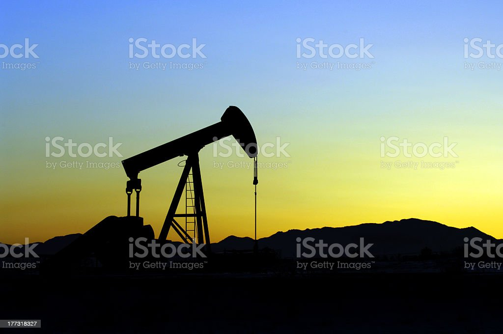 Oil Pumper at sunset stock photo