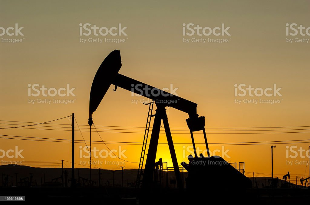 Oil Pumpjack Against a Sunset Sky stock photo