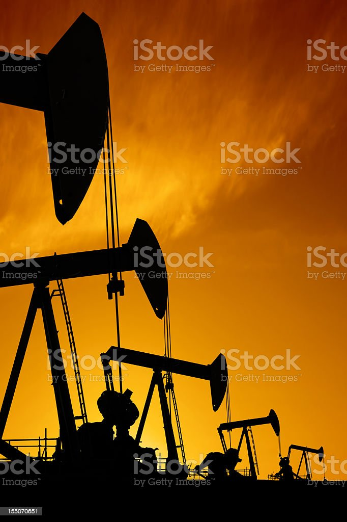 XXXL oil pumpjack silhouettes royalty-free stock photo