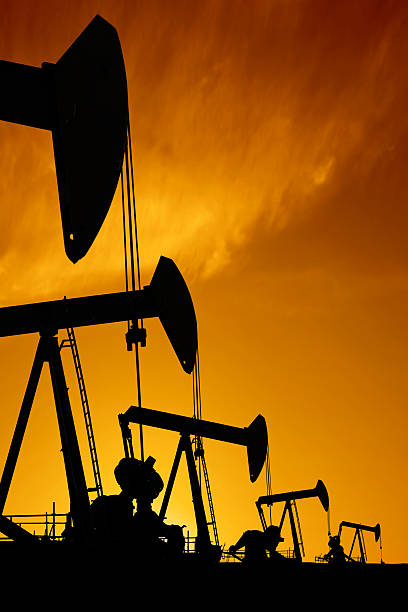 XXXL oil pumpjack silhouettes stock photo