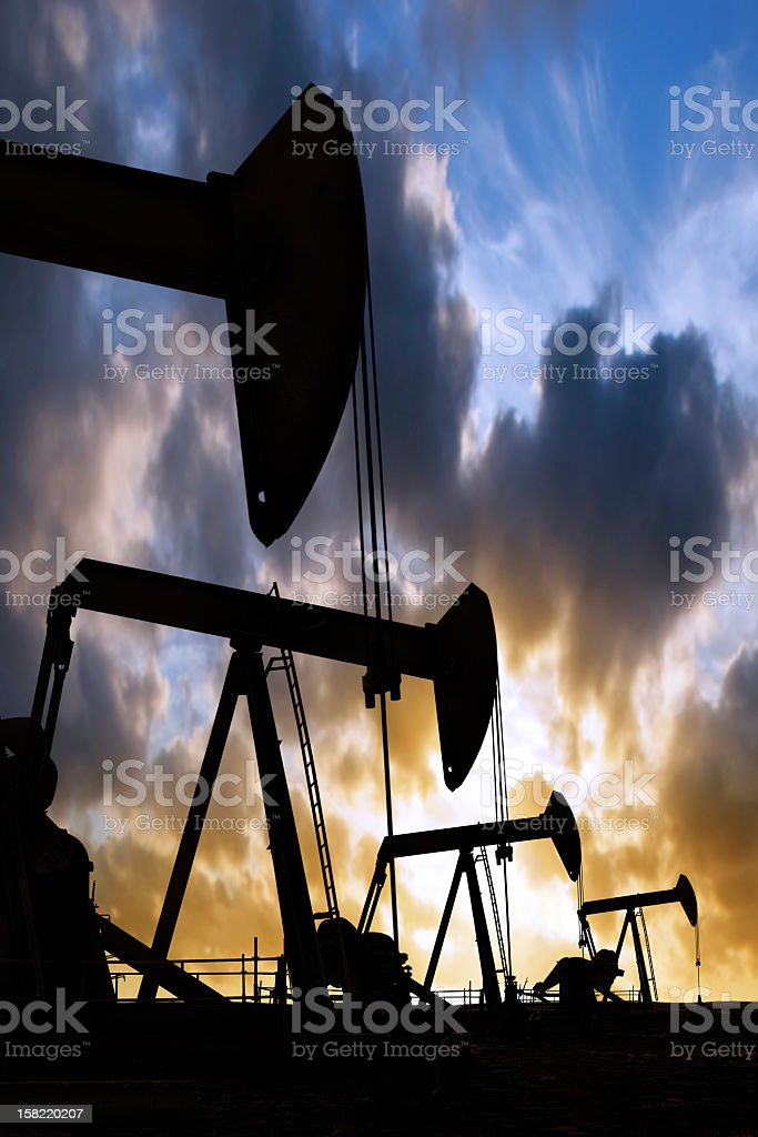 XXL oil pumpjack silhouettes royalty-free stock photo
