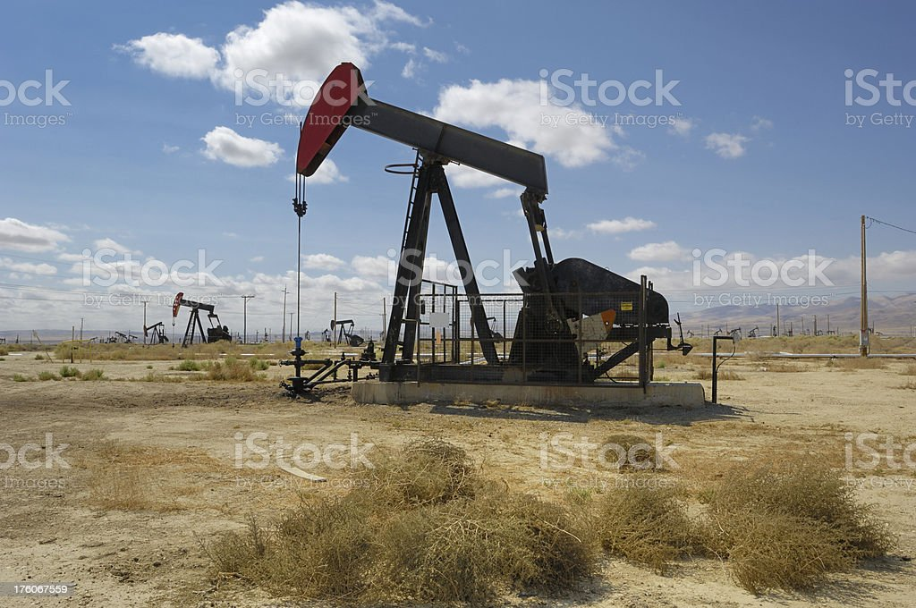 Oil Pumpjack with Tumbleweed in Foreground stock photo