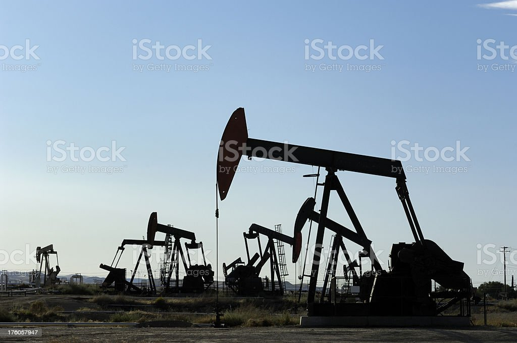 Oil Pumpjacks Silhouetted Against Dusk Sky royalty-free stock photo