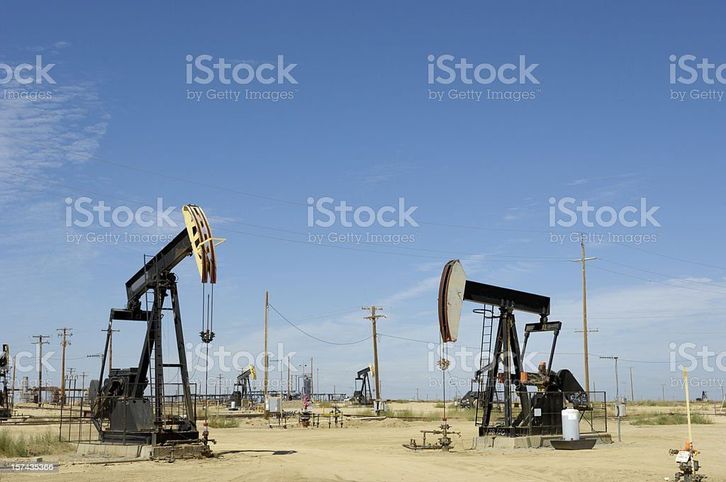 Oil Pumpjacks with Others in Background stock photo