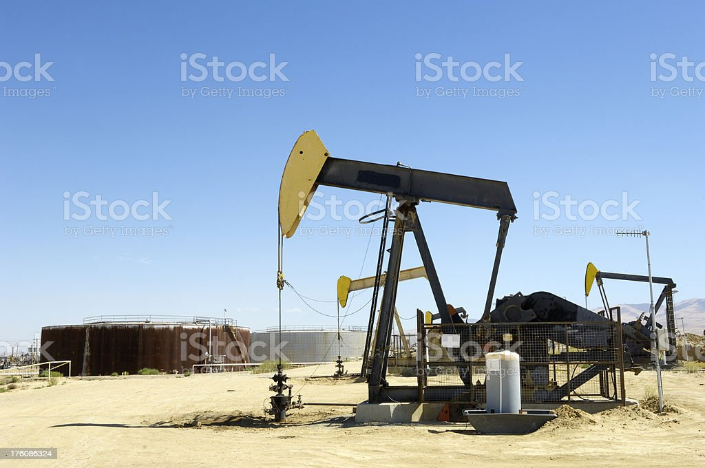 Oil Pumpjacks with Storage Tank in Background stock photo