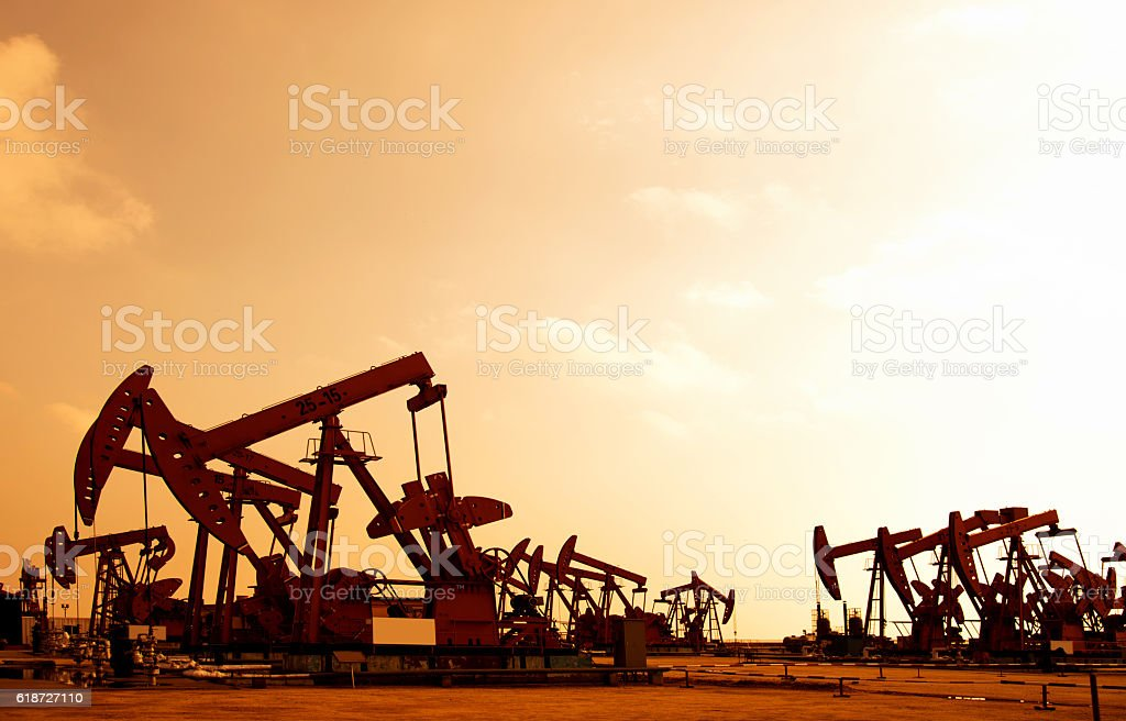 Oil pumps and rig at sunset stock photo