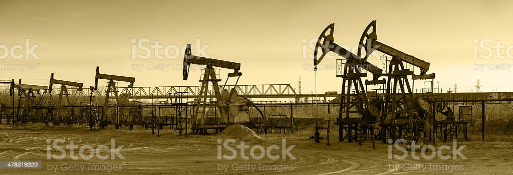 Oil pumps on a oil field. stock photo