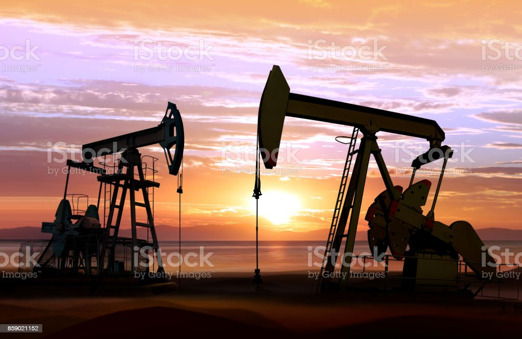oil pumps on sunset stock photo