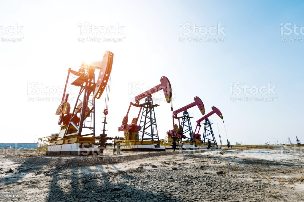 Oil pumps working under the sky stock photo